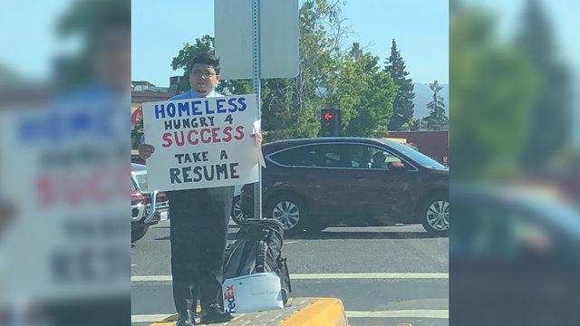 Homeless man hands out resume in lieu of begging | WSB-TV