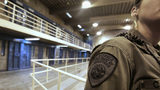 A California Department of Corrections and Rehabilitation correctional officer is seen in one of the housing units at Pelican Bay State Prison near Crescent City, California.
