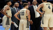 Wake Forest assistant coach Jamill Jones, second from left,was arrested after police said he threw a punch that killed a New York City tourist.