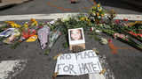 Flowers surround a photo of 32-year-old Heather Heyer, who was killed when a car plowed into a crowd of people protesting against the white supremacist Unite the Right rally, August 13, 2017 in Charlottesville, Virginia.