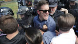 "White nationalist Richard Spencer (C) and his supporters clash with Virginia State Police in Emancipation Park after the ""Unite the Right"" rally was declared an unlawful gathering August 12, 2017 in Charlottesville, Virginia."