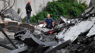 Italian bridge collapse: More than 20 killed when raised highway gives way in Genoa