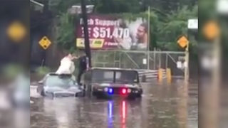 Bride, still in wedding gown, rescued from car