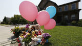 Tributes grow outside the home where a pregnant woman and her two daughters lived Thursday, Aug. 16, 2018, in Frederick, Colo. AP Photo/David Zalubowski)