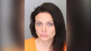 Woman accused of punching police officer in face, yelling racial slurs at him