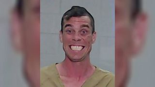 Man accused of robbing thrift store smiles in mugshot after arrest