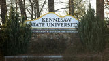A former cheerleader at Kennesaw State University filed a lawsuit accusing university and elected officials of violating her civil rights during a dispute over the decision she and other cheerleaders made to kneel during the national anthem.