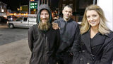 Johnny Bobbitt, left, Kate McClure, right, and McClure's boyfriend Mark D'Amico remain embroiled over a legal battle regarding money raised for the homeless veteran last year.