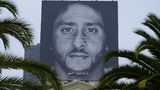 A billboard on top of a Nike store shows former San Francisco 49ers quarterback Colin Kaepernick. A small university in Georgia is cutting ties with Nike in response to the ad. (AP Photo/Eric Risberg)