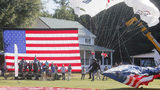 Skydivers parachuted into the yard outside the Barnesville home donated to Gold Star widow Sarah Schaaff by the Tunnel to Towers Foundation. (BOB ANDRES /BANDRES@AJC.COM The Atlanta Journal-Constitution)