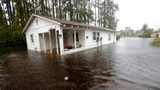 A home is seen in floodwaters from Hurricane Florence in Marion, S.C., Sunday, Sept. 16, 2018. Volunteers are rescuing animals who were left behind as flood waters rose in both South and North Carolina.