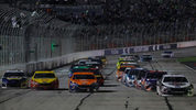 Race car drivers speeding into turn one during the Monster Energy NASCAR Cup Series Folds of Honor QuikTrip 500 at Atlanta Motor Speedway on February 25, 2018 in Hampton, Georgia. Photo: Kevin C. Cox/Getty Images