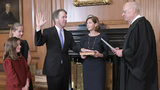 Retired Justice Anthony M. Kennedy, right, administers the Judicial Oath to Judge Brett Kavanaugh in the Justices' Conference Room of the Supreme Court Building. Ashley Kavanaugh holds the Bible.