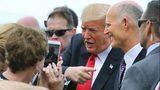 Accompanied by Florida governor Rick Scott, President Trump is welcomed at Orlando International Airport, Monday, Oct. 8, 2018. Photo: Joe Burbank/AP