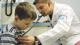 File photo of a doctor examining a child.