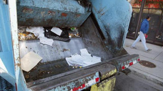 Trash collector gives boy, 2, toy garbage truck