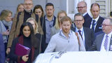 In this image made from video, Britain's Prince Harry, center right, and his wife Meghan Markle, left, Duke and Duchess of Sussex, approach a car at an airport in Sydney, Monday, Oct. 15, 2018. (Australian Pool via AP)