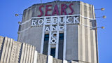 This Wednesday, March 22, 2017, photo shows Sears signage on its department store in Brooklyn's Flatbush neighborhood in New York.
