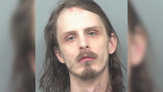Man hits ex for taking too long at Walmart, stabs dad, police say