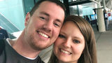 In this selfie provided by Clark and Heather Ensminger, Clark Ensminger, left, poses with his wife Heather in Nashville, Tenn., marking the cross-country trip they are taking to see every U.S. Disney park in a single day.