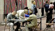 In this Tuesday, Nov. 2, 2004, file photo, a group of voters fill out their ballots at a table rather than wait for an empty voting booth at the Civic Center in Dodge City, Kansas. (Photo: Michael Schweitzer/Dodge City Daily Globe via AP)