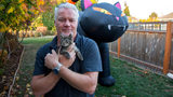Chuck Hawley poses with his new kitten, Sticky, on Tuesday, Oct. 22, 2018 in Silverton, Ore. Hawley found Sticky glued to the side of the road and took her in.