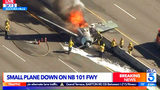 This photo taken from video and provided by KTLA-TV shows a vintage North American AT-6 airplane that crashed on U.S. 101 in Agoura Hills, Calif., Tuesday, Oct. 23, 2018. The pilot escaped uninjured and no one on the ground was hurt.