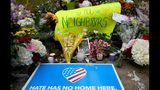 Flowers and cards were placed at a makeshift memorial down the street from the site of the mass shooting that killed 11 people and wounded 6 at the Tree Of Life Synagogue on October 28, 2018 in Pittsburgh, Pennsylvania.