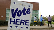 In this Oct. 23, 2018, file photo people arrive for early voting at a polling place in Charlotte, N.C.  Photo Credit: AP Photo/Chuck Burton, File