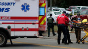 A person is transported from the scene of a shooting at a yoga studio in Tallahassee, Florida, on Friday, Nov. 2, 2018. A gunman killed two women and wounded five others when he opened fire on people inside.