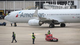 American Airlines settled a lawsuit, meaning customers may be able to get money if they are eligible.