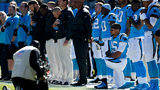 Eric Reid kneeled Sunday before the Panthers game against the Buccaneers. (Photos: WSOCTV.com)