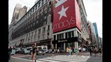 People walk past Macy's flagship store in Herald Square, August 11, 2016 in New York City. On Thursday, Macy's announced plans to close 100 stores nationwide.