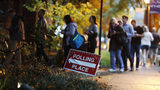 A line forms outside a polling site on election day in Atlanta, Tuesday, Nov. 6, 2018.