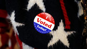 Maria Morahn, of Osceola, Iowa, wears a sticker after casting her ballot in the general election, Tuesday, Nov. 6, 2018, at the United Methodist Church in Osceola, Iowa.