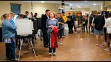 A steady steam of people vote at the St Mary's Orthodox Church in Roswell, Ga., Tuesday, Nov. 6, 2018. (Bob Andres/Atlanta Journal-Constitution via AP)