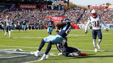 Jonnu Smith caught a touchdown pass for the Tennessee Titans on Sunday. A fan trying to catch a free T-shirt was critically injured when he fells from the stands.