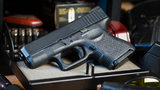 Company that makes bullet-embedded glassware gives gun to employees for Christmas