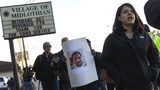 Protesters rally for Jemel Roberson on Nov. 13, 2018, outside the Midlothian Police Department in Midlothian, Ill. Roberson, 26, was fatally shot by a Midlothian police officer Nov. 11 as he subdued a gunman.  (Brian Cassella/Chicago Tribune via AP)