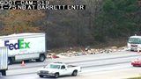 Two FedEx trucks were involved in a crash on I-75 in Cobb County, Georgia, Monday afternoon, sprawling packages across the interstate.