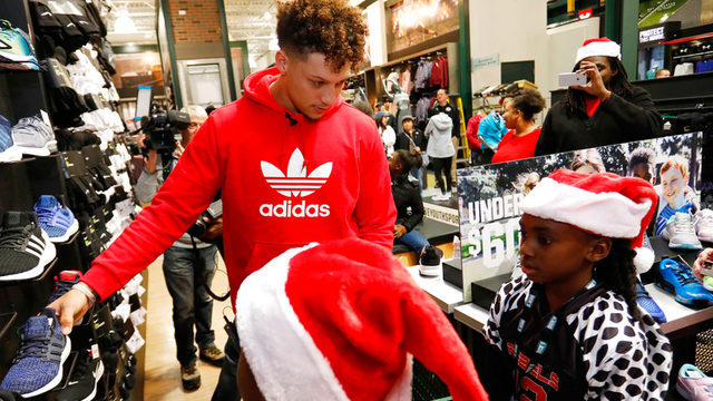 d25289562 ... II serves as a personal shopping assistant for players from local KC  United youth football organization at the DICK S Sporting Goods