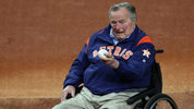 George H.W. Bush examines the baseball before Game 5 of the 2017 World Series at Minute Maid Park in Houston.