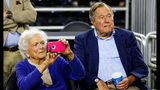 Former First Lady Barbara Bush and former President George H.W. Bush look on prior to the South Regional Final of the 2015 NCAA Men's Basketball Tournament on March 29, 2015 in Houston, Texas. Photo: Tom Pennington/Getty Images