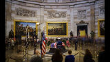 Members of the public file through the Capitol Rotunda to view the casket of the late former President George H.W. Bush as he lies in state, December 4, 2018 in Washington, DC. Drew Angerer/Getty Images