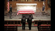 Houston Police officers pay their respects at the flag-draped casket of former President George H.W. Bush St. Martin's Episcopal Church Wednesday, Dec. 5, 2018, in Houston.