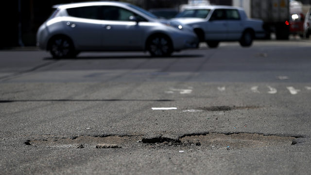 Woman Places Christmas Tree In Pothole After It Goes Unfixed