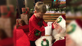 Boy who is blind, with autism, meets Santa; photos go viral