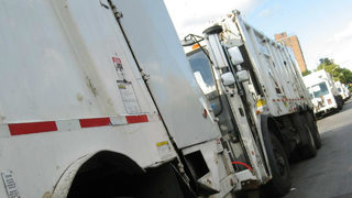 Trash collector surprises day care kids with toy garbage trucks