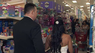 Groom surprises bride, guests with Toys for Tots shopping spree