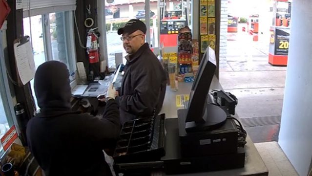 police in california said a woman held up a gas station clerk with a knife the incident was caught on video